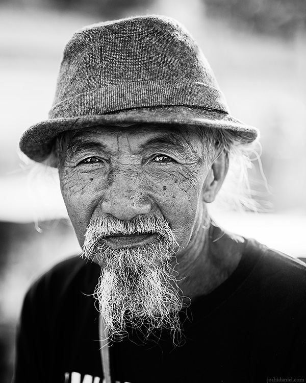 Portrait of a bearded old man in Uluwatu, Bali, Indonesia