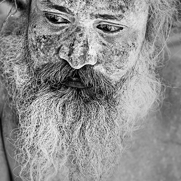 Portrait of an ash smeared sadhu in Varanasi, Uttar Pradesh, India
