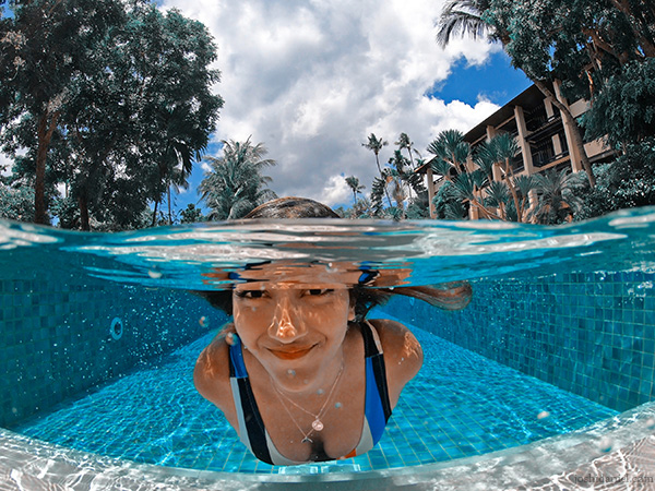A GoPro HERO7 Black over/under photo of Larissa Dsa in the swimming pool in Koh Samui, Thailand