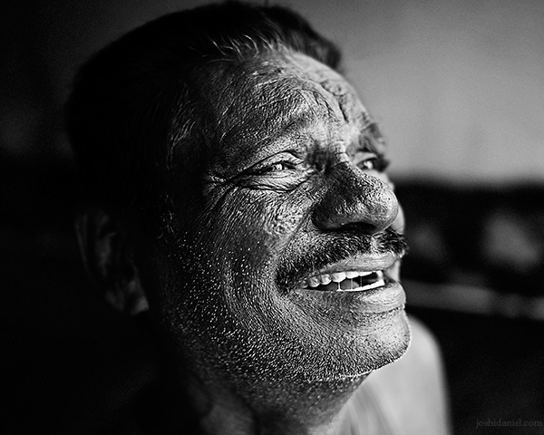 A 28mm wide angle black and white portrait of Aziz in Trivandrum, Kerala, India