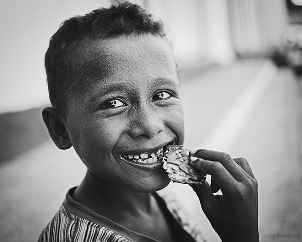 A 28mm wide angle black and white portrait of a young boy from Tual, Maluku, Indonesia
