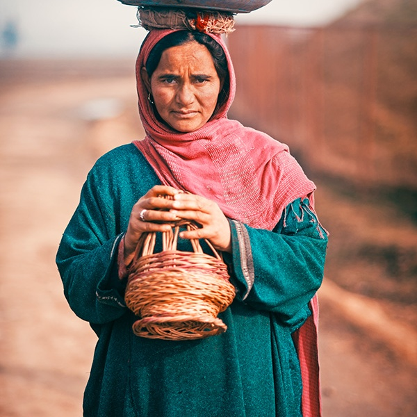 Portrait of a Kashmiri woman with Kangri in Lolab Valley, Kupwara, Jammu and Kashmir, India