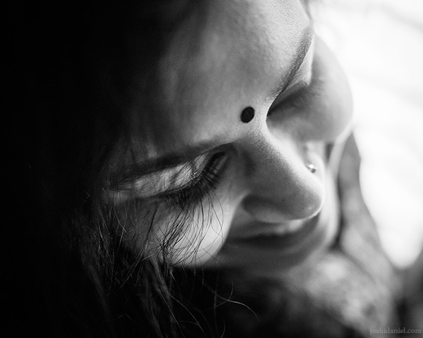 A 28mm wide angle black and white portrait of a shy Parvathy Krishnan in Bangalore, Karnataka, India