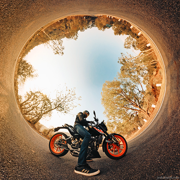 Inverted little planet (tiny planet) self-portrait of joshi daniel on KTM Duke in Tumkur, Karnataka, India