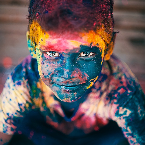A vibrant portrait of a boy during the festival of Holi in Sowcarpet, Chennai, Tamil Nadu, India
