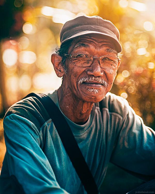 Portrait of a smiling old man in Senggarang Village, Bintan, Indonesia