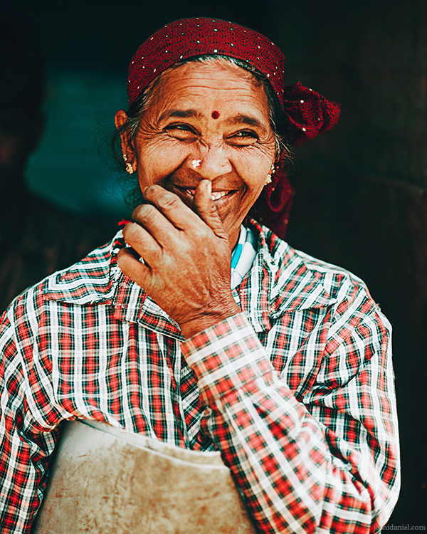 Portrait of a smiling tea estate worker at Top Station, Munnar, Kerala, India