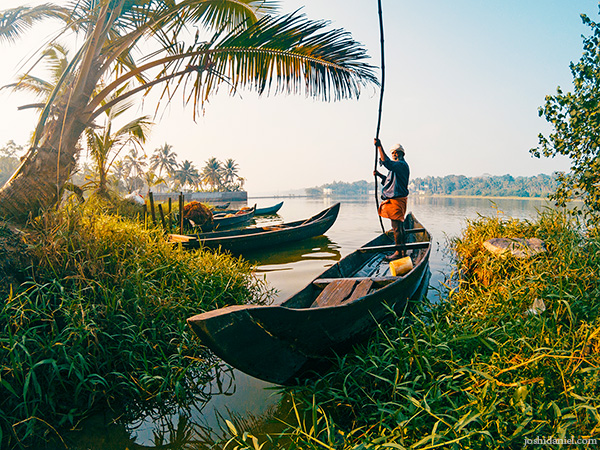A man rowing a boat in Vellayani Lake, Trivandrum, Kerala, India