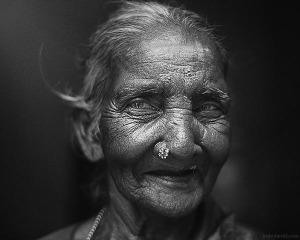 Black and white portrait of a smiling Govindamma taken at Prasad studio in Saligramam, Chennai, Tamil Nadu, India