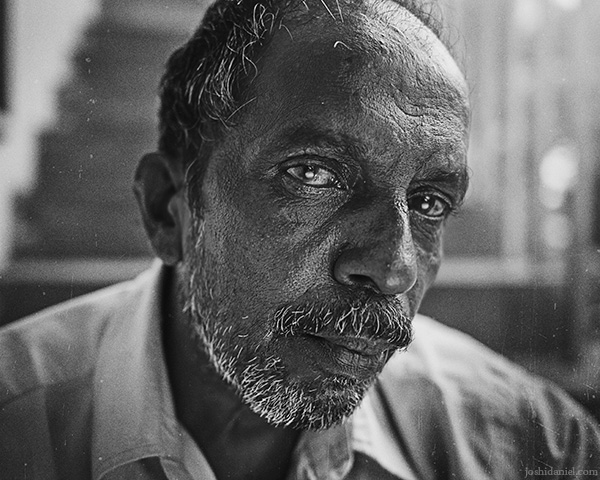 A 28mm wide angle black and white portrait of Rajasekaran chettan from Trivandrum, Kerala, India