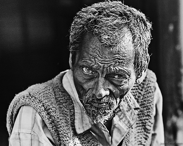 Black and white street portrait of a man in Allahabad, Uttar Pradesh, India
