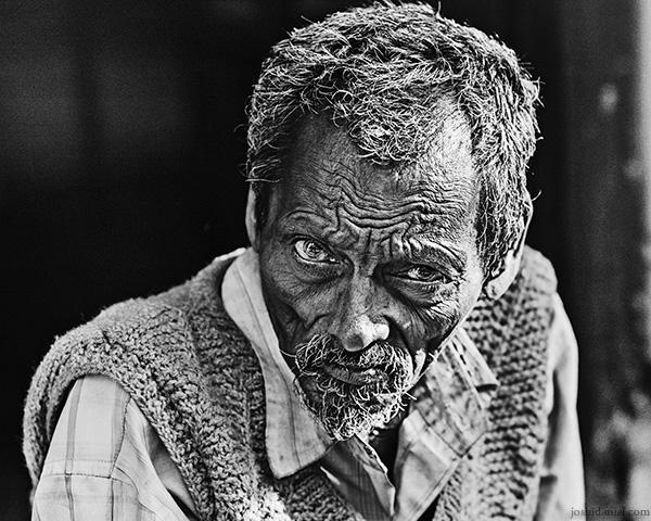 Black and white street portrait of a man in Allahabad, Uttar Pradesh, India