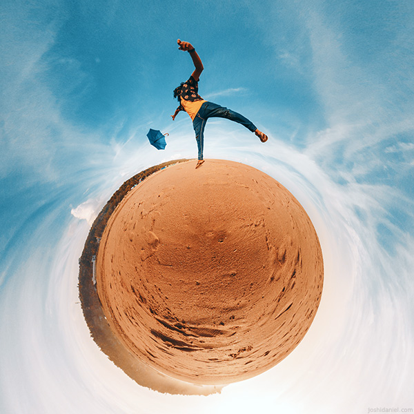 Little planet (tiny planet) photograph of Abilash Thankan jumping with an umbrella on a beach in Trivandrum, Kerala, India