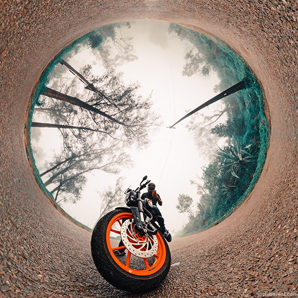 Inverted little planet (tiny planet) self-portrait of joshi daniel on KTM Duke in Ponmudi, Trivandrum, Kerala, India