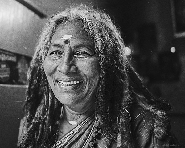 A 28mm wide angle black and white portrait of a woman with dreadlocks in Trivandrum, Kerala, India