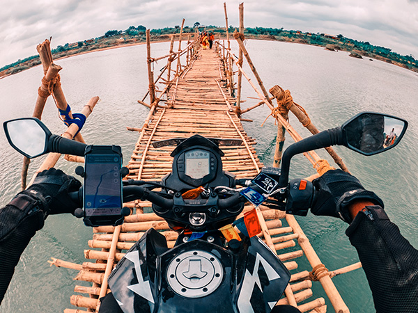GoPro self-portrait of joshi Daniel crossing the bamboo bridge over Ajay river in West Bengal, India on KTM Duke