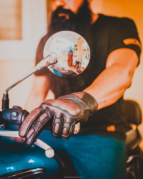 Self-portrait of joshi daniel wearing vamos gloves on the Royal Enfield Meteor.